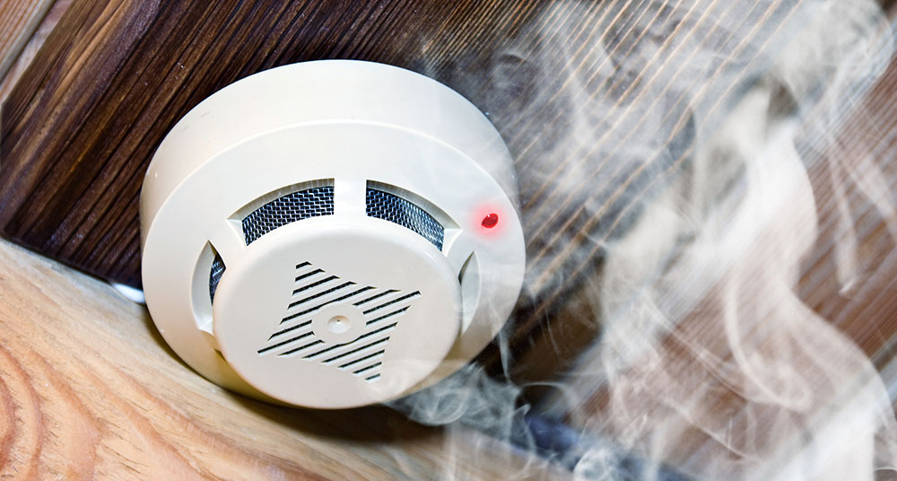 Smoke around a fire preventing smoke detector